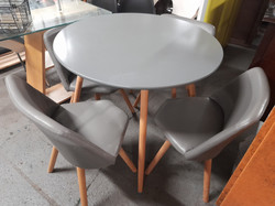GREY TABLE AND FOUR FAUX LEATHER CHAIRS £85 THE TABLE TOP HAS SOME SCRATCHES