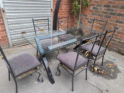 GLASS TABLE AND SIX CHAIRS £85
