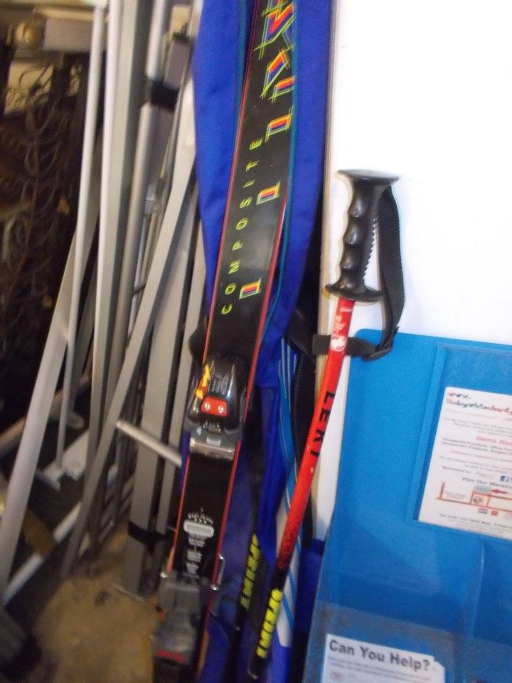 PAIR OF SKIS AND POLES £20
