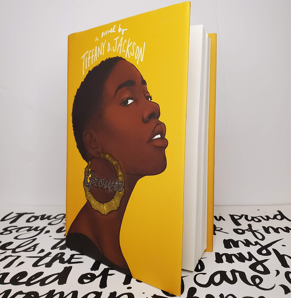 image of the book Grown by Tiffany D Jackson in front of a white background with black calligraphy writing