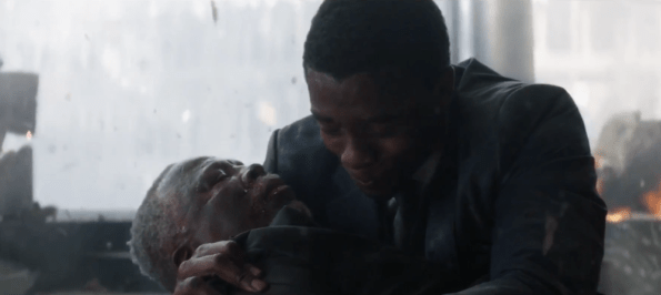 Chadwick Boseman as T'challa (The Black Panther) mourns his father