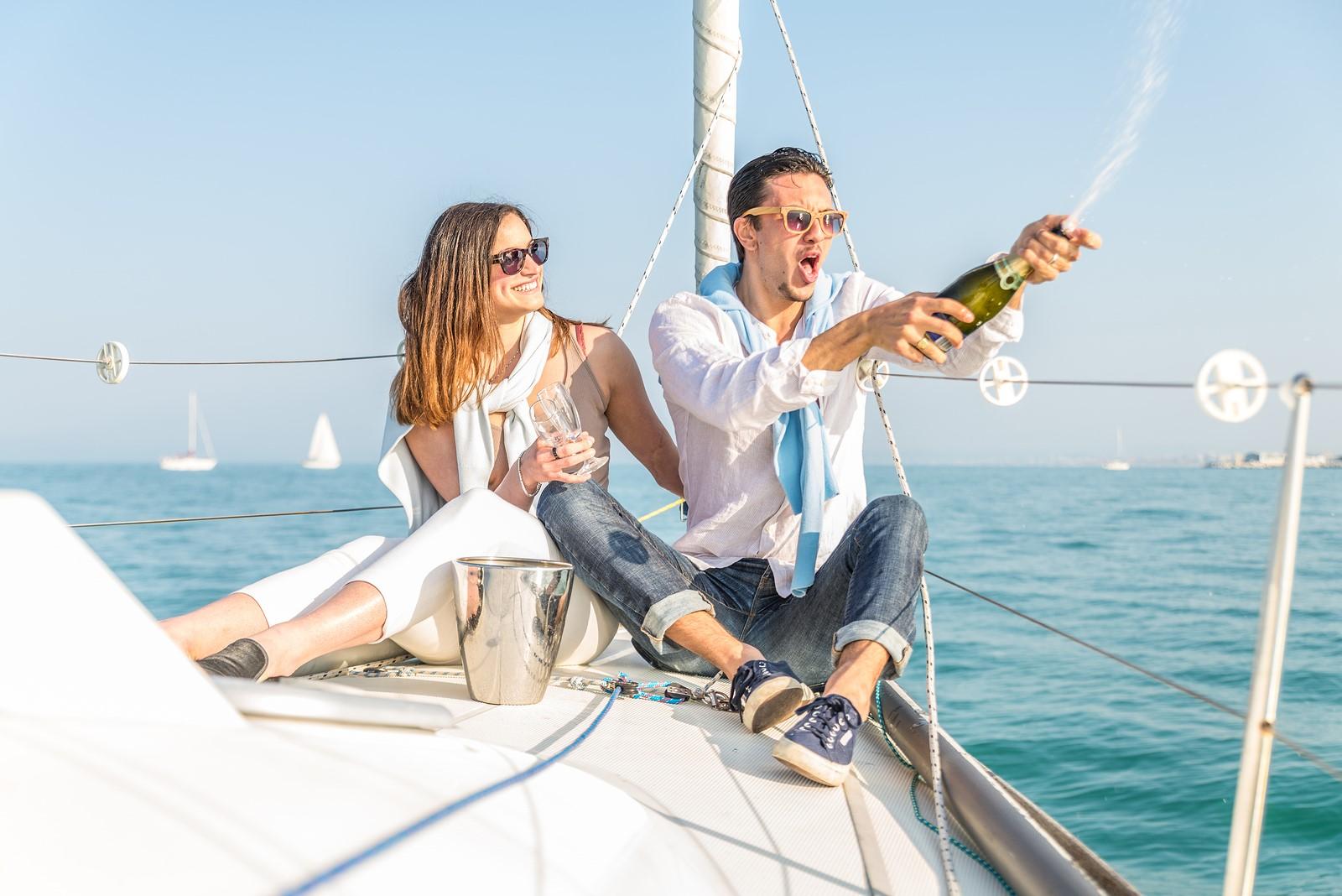 bigstock-Couple-Celebrating-On-The-Boat-87866582