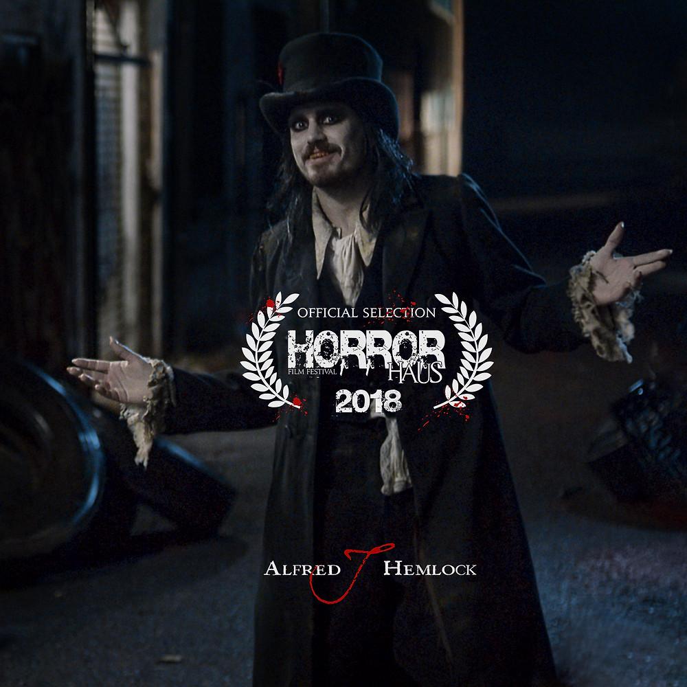 Alfred J Hemlock with the HorrorHaus Film Festival laurel