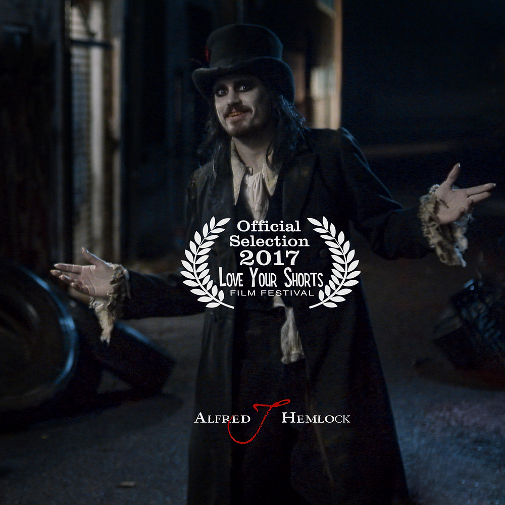 Alfred J Hemlock with the Love Your Shorts Film Festival acceptance laurel