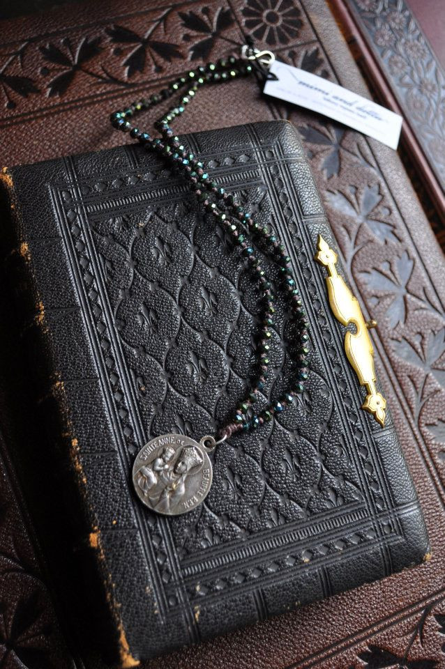 Vintage medal on handmade beaded necklace