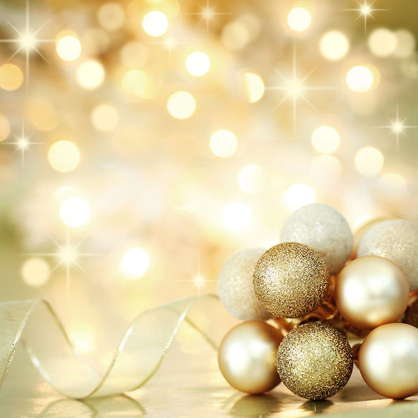 Gold Christmas baubles and ribbon on bac