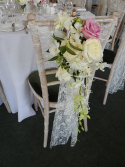 Lace sash and fresh flowers
