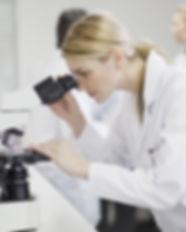 Female Scientist Using Microscope