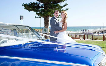 A brilliant wedding day for the bride and groom sun shinning photos with our original blue chevrolet in front of the jetty Grange Beach South Australia