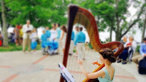Caresse Boyers playing harp at Marblehead Lighthouse