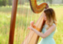 playing harp at outdoor wedding