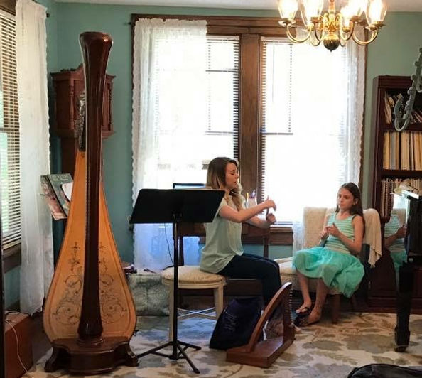 Caresse Boyers teaches a first harp lesson