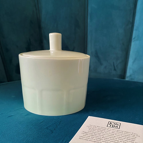 Candle in porcelain container with lid