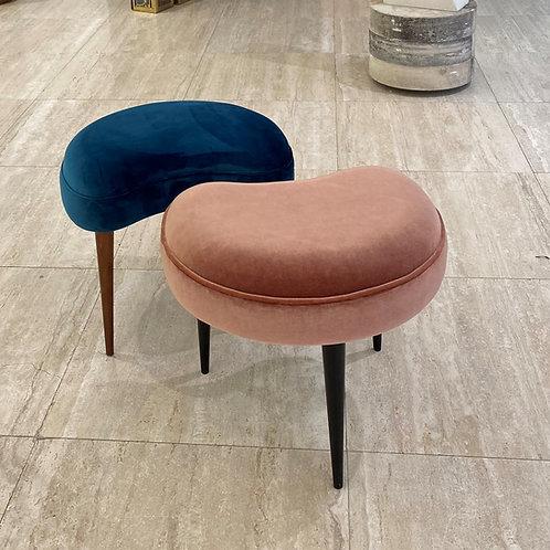 Kidney shaped three-legged stool