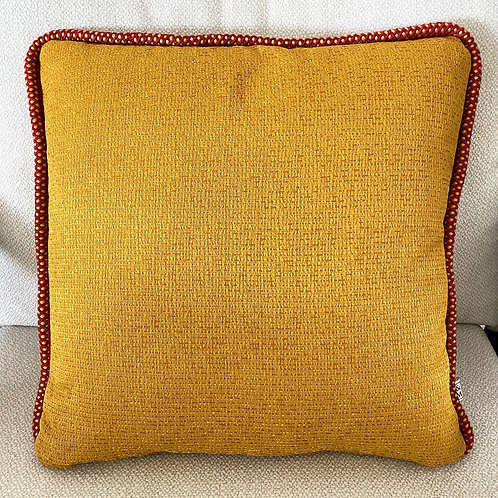 Mustard cushion with red cord