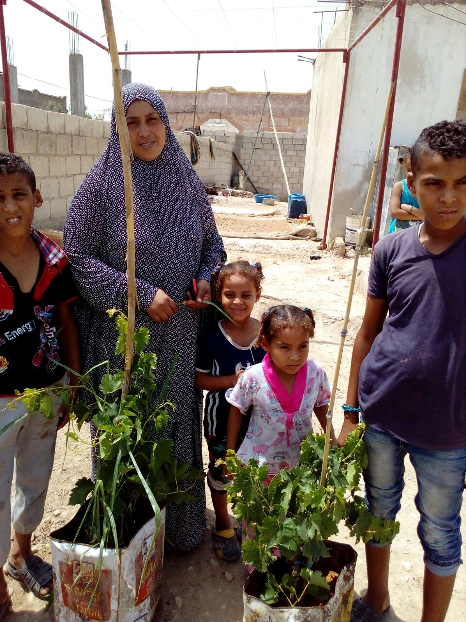 Ghor Family Receives Grap Plants 2017-07-14