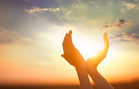 Hands Holding The Sun At Dawn.jpg