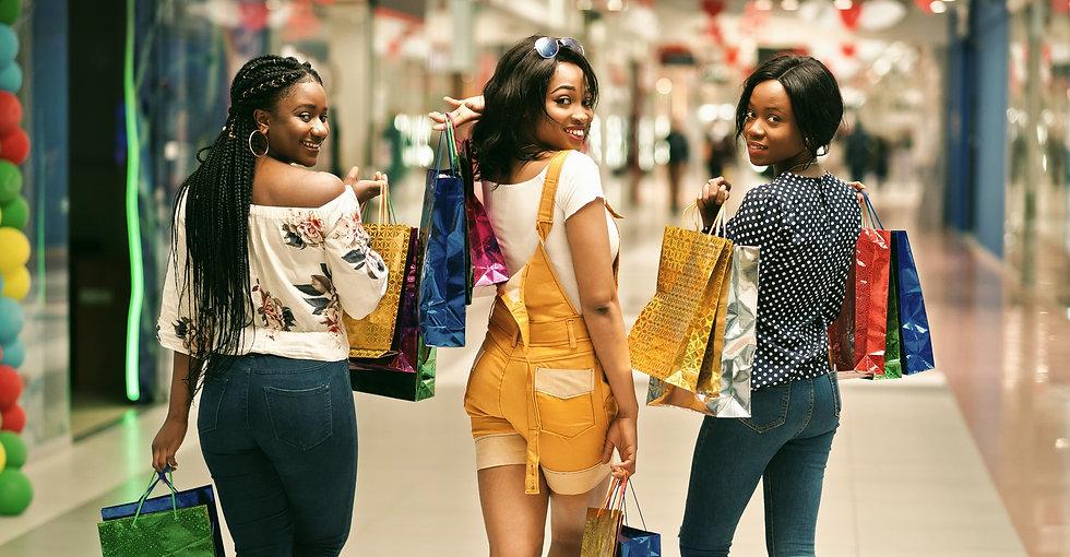 shutterstock_1370042735 three girls in a mall_edited_edited.jpg
