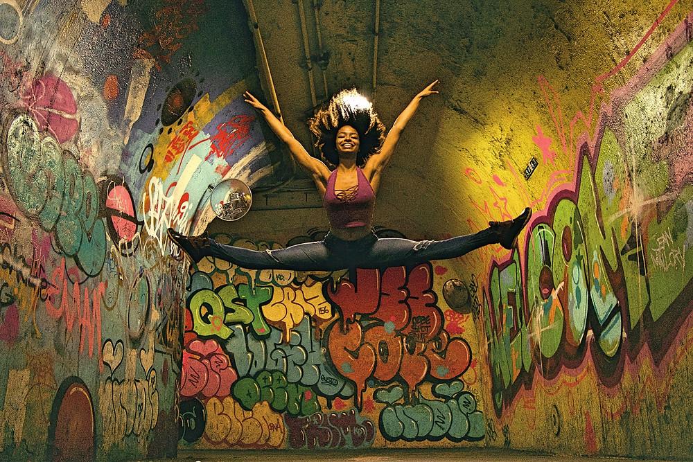 Ballerina, dancer jumping in subway station, graffiti