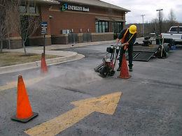 Saw cutting asphalt damage for removal