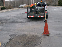 Asphalt damage in parking lot
