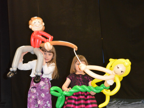 """Beautiful young ladies show off the work of Angela from """"The Main Event"""" in Port Elgin; a balloon sculpure which was made right before our eyes."""