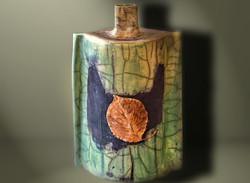 Vase with leaf.