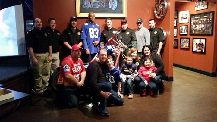 Facebook - The HV GunsandHoses group and the winner of the Odessa Turner  signed football