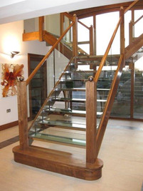 Timber, stainless steel and glass stair