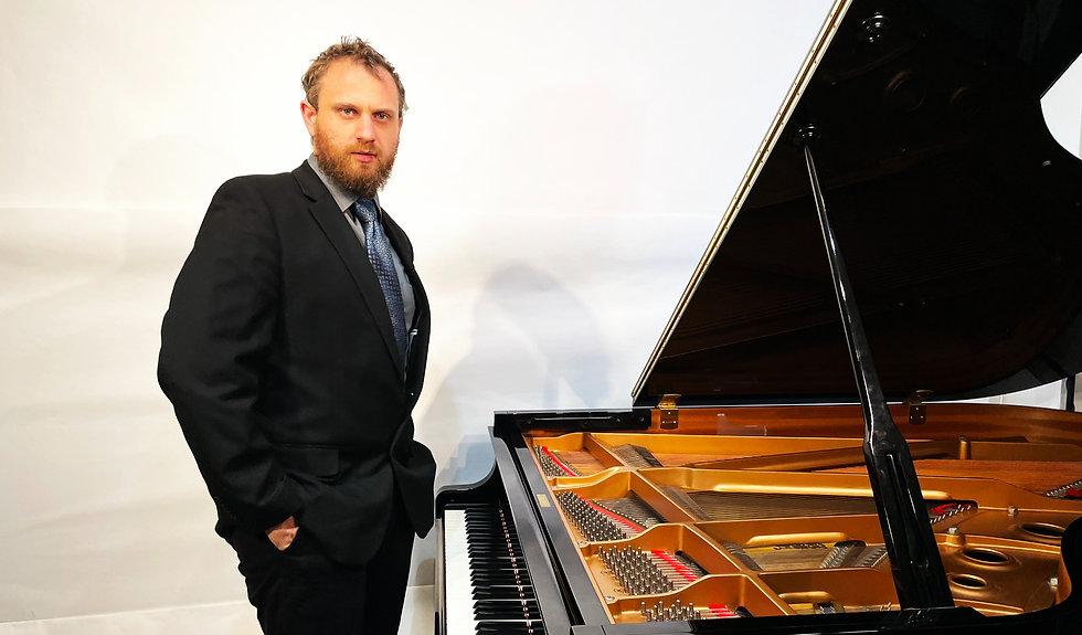 Copy of Tim Chernikoff standing at piano_edited.jpg