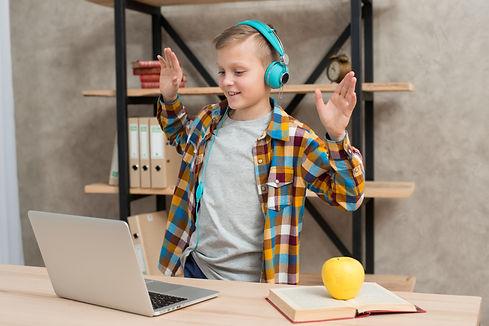 boy-listening-music-laptop.jpg