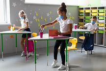 kids-standing-their-desk-while-wearing-m