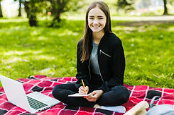 cute-girl-studying-park.jpg