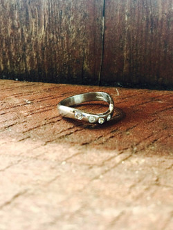 Waved women's engagement ring