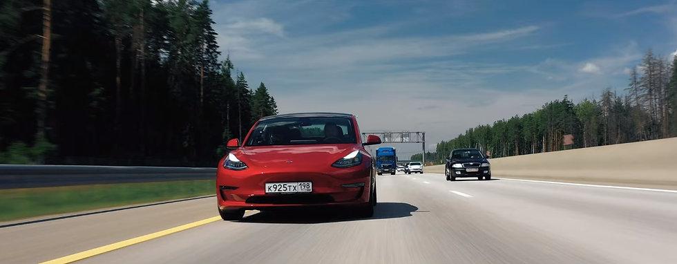 tesla-model-3-red-performance-on-road.jpg