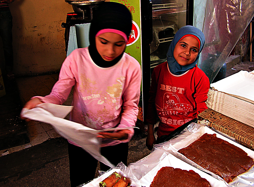 Lebanese girls working in parents' sweet shop, Beirut