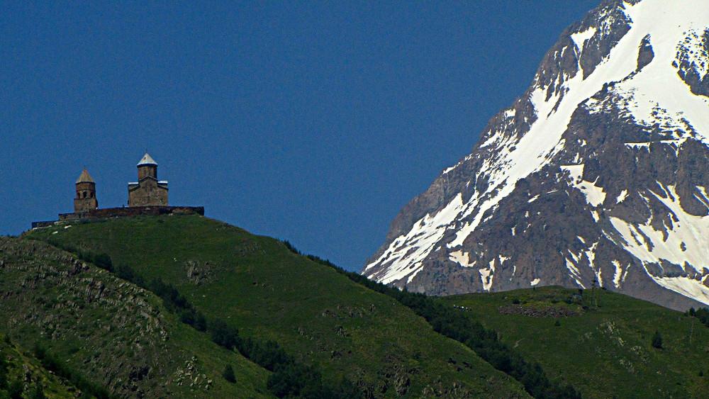 View of Tsminda Sameba and Mount Kazbegi from Kazbegi, Georgia