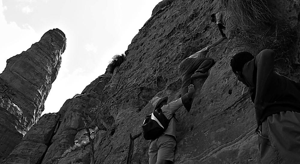 Climbing a rock face to a Tigray rock hewn Church, Ethiopia
