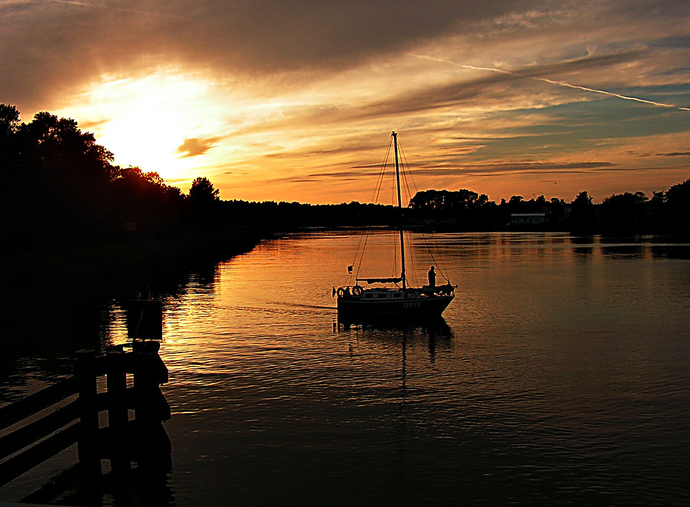 Boat at sunset near Dzwinów, Baltic Coast, northern Poland