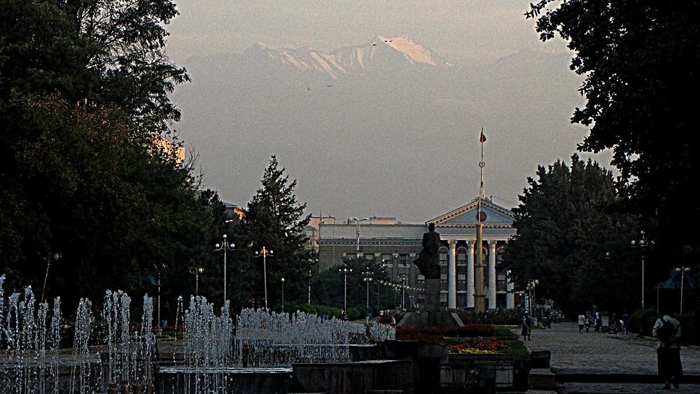 The Alai mountain range rising behind Bishkek, Kyrgyzstan
