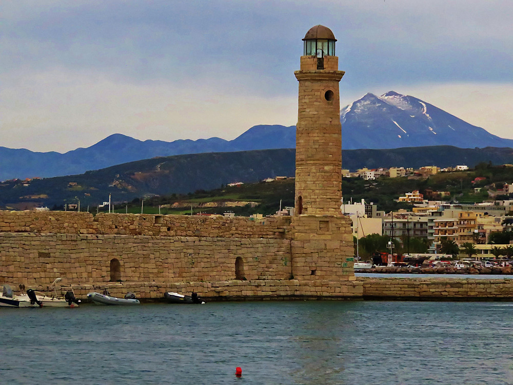 Rethymno's lighthouse and harbour area - Lefka Ori mountains in the background, Crete