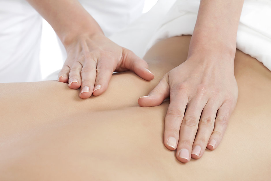 Image of a Masseuse giving a relaxing back massage at a spa.jpg
