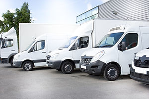 white delivery vans truck on parking in