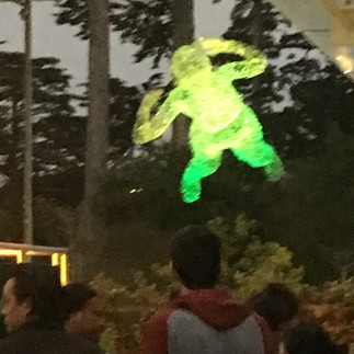 Floating figure installation at the Academy of Science during their Nightlife event for Outside Lands.
