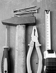 Black and white image of DIY tools and h