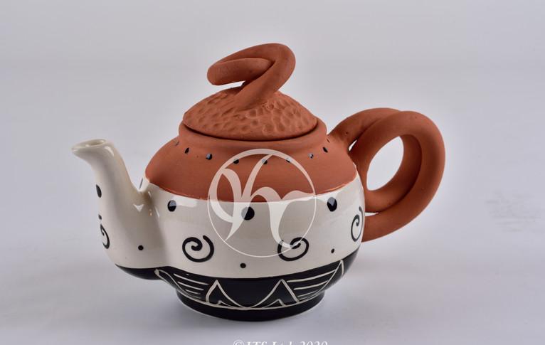 Terracotta swirl Teapot.JPG