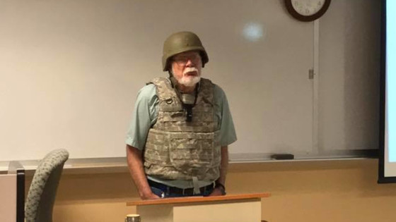 Professor Charles K. Smith of San Antonio College wore a helmet and tactical vest to class because s