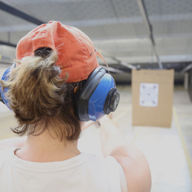 A student practices marksmanship and safe gun handling in a carefully controlled setting