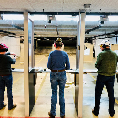 NRA Basic Pistol students getting comfortable with shooting. Because it's fun!