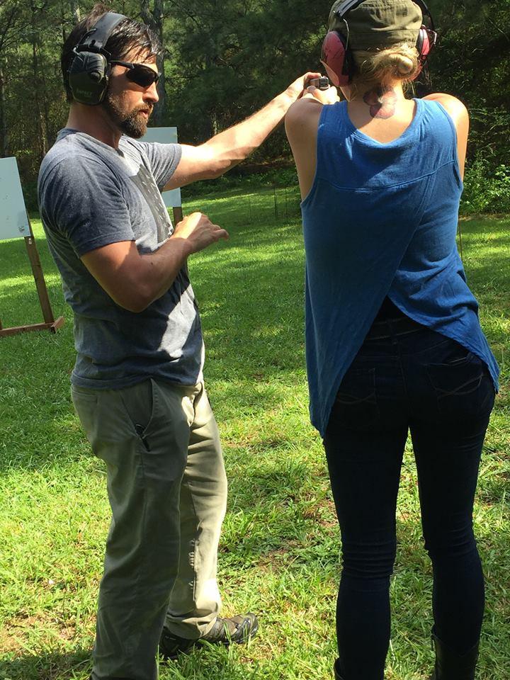 John Lovell of Warrior Poet Society instructs Abigail Summar of Mountain Rose Defensive Training in Powder Springs, Georgia